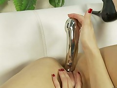 Naked brunette Sheena Ryder with small tits spreads her legs and bangs her lovely muff with her favorite toys. There are many dildos for her wet snatch. She can't live without masturbating