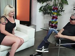 Blonde haired MILF Missy Monroe with large breasts strips naked in front of a favourable man. She flaunts her sexy tits and then man grabs her juicy ass cheeks. He loves her body