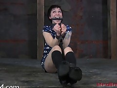BDSM session with a short haired brunette slut in the dungeon