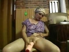 Aged laddie uses huge dildo on herself