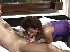 Lingerie clad wife sucking hard cock