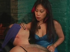 Mature Asian Dominatrix Sits Submissive Clear the way on the Bondage Chair