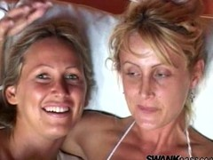 Lesbian cougars in stockings enjoy licking and toying their pussies in close up