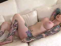 Gorgeous babe named Hollie Hatton shows her sexy tattoos and big boobs