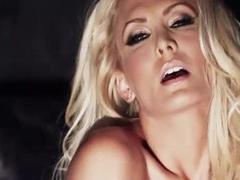 Erotic tease blonde in heels and stockings