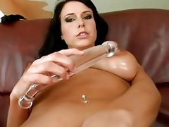 Big tit hottie shoves giant glass dildo in pussy