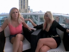Blondes show off their big tits to each other