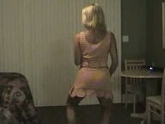 Mature blonde milf dancing and gets her large tits out and flashes her pussy too.