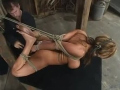 Busty slut tied there and used by her master