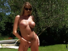 Danielle Maye is a large breasted busty goddess. This babe is proud of her perfect body and undresses out of her pin bikini in a playful manner. Watch busty heartbreaker in shades strip naked in the sun