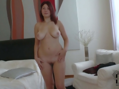 Attractive pale redhead babe Nanny with curvy thighs and big natural hooters gets naked and teases dirty dude during the time that he films her in bedroom in point of view