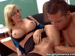 Busty and aroused teacher blonde Holly Sampson enjoys in getting her hairless and wet pussy fingered and licked by her best student Danny Wylde and enjoys in after school activities