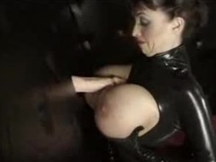 Illustrious tit chick in latex gives gloryhole blowjob