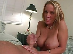 Busty blonde hottie gives her man a hard handjob