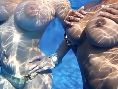 The question here is, Will they float? And the answer is yes. Valory Irene and Chica immerse themselves in a dreamy and serene water world of floating breastesses in this super-natural SCORE video. Their buoyant boobs float because breasts have a lower density than water. Science can be fun.