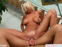Blonde playgirl in glasses Emma Starr gives titjob