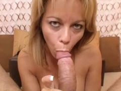 Blonde cougar with tall jugs giving a titjob