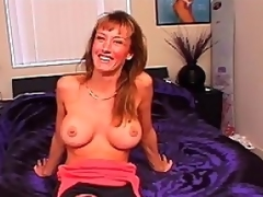Busty blond milf Julie Fay looks like she has been wanting to be in a porn scene for ages!  She cant wait to show off her recent and improved breasts, peeling off her singlet with virtually no prompting whatsoever.  The cameraman reaches out and tweaks her nipples, watching with delight as they grow hard with arousal.  Next you see Julie on her knees, eagerly blowing the cameraman in..