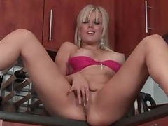 Perfect big boobs golden-haired shows off in kitchen