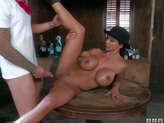 Dirty and arousing busty dark haired cowgirl Jewels Jade enjoys in seducing a cowboy and giving him a naughty blowjob and a ride in the bar and enjoys in hardcore action