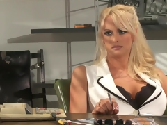 Breasty and arousing nurse Stormy Daniels poses in office