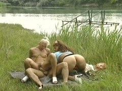 Teenage threesome fun outdoors under scorching summer sun