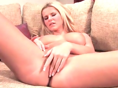 Blond beauty fondles her big sexy tits