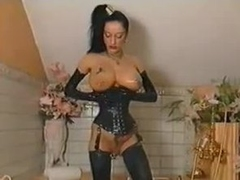 Leather corset makes her waist tiny